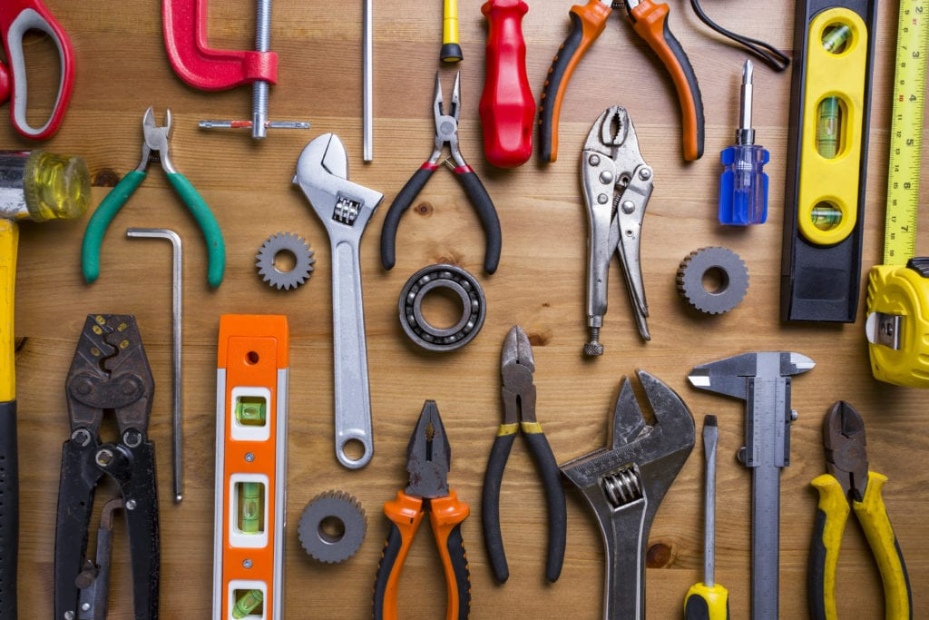 other business tools and resources. Hand tools arranged on a wooden table.