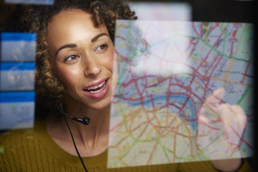 NEMT property insurance dispatcher using GPS location system