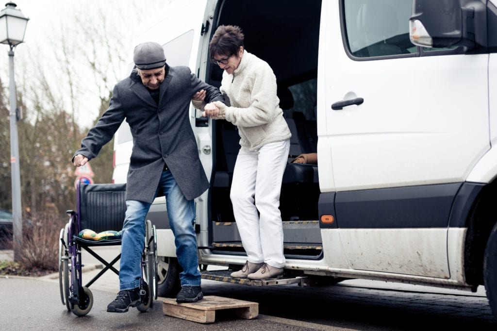non emergency medical transportation general liability insurance driver helping man out of van