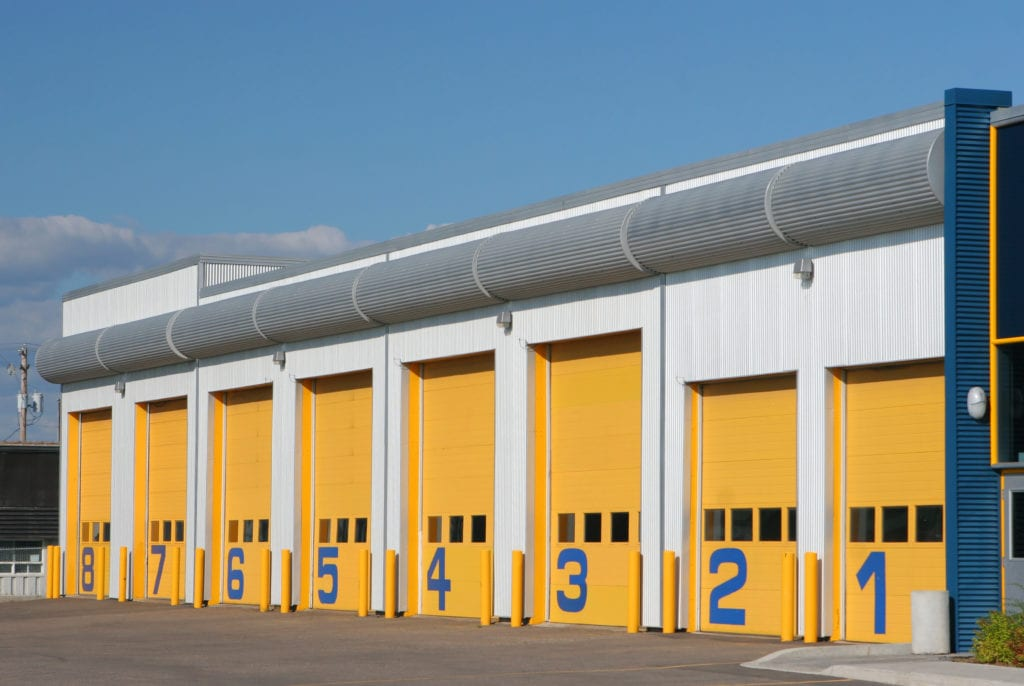 Garage insurance property coverage. Exterior of an auto repair garage building.