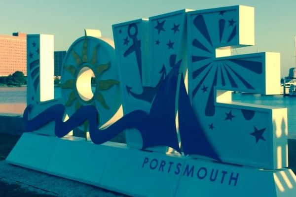 Virginia's trademark LOVE sign, Portsmouth version, white letters with yellow sun and blue nautical theme.
