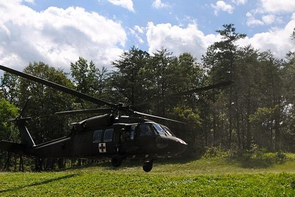 Bowling Green, VA insurance agency, Army medevac helicopter landing on green field at Fort AP Hill.