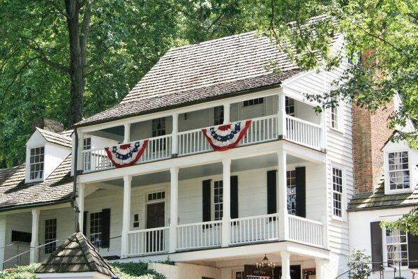 Charlottesville, VA insurance agency, Michie Tavern 1784 a large white two-story wood sided home with double decker porch.