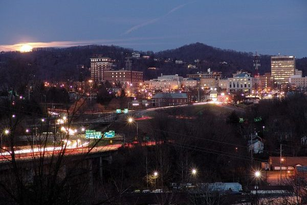 Asheville, NC Insurance Agency, the city lighted at night.
