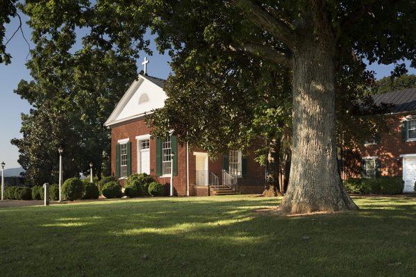 Bedford, VA Insurance Agency, nearby St. Stephen's Church, low morning sun on brick church building.