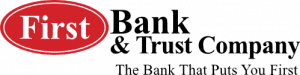 """First bank and trust company logo, red oval encircling""""First"""" with remaining text in black letters."""