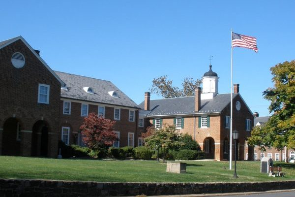 Fairfax, VA old county courthouse, two story brick buildings with blue slate roofs.