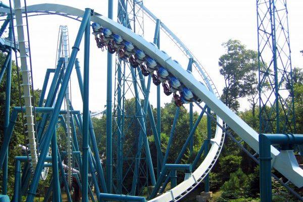 Newport News, VA Busch Gardens blue roller coaster suspended below metal tracks, zipping by in motion blur.