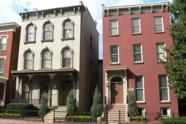 Richmond, VA downtown Putney Houses three story brick buildings, one with ornate arched windows, on a city street.