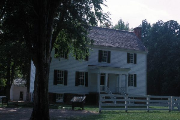 Sutherland, VA Pamplin Historical Park two story white clapboard sided home with cedar shingles.