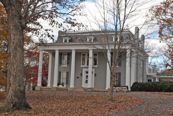 Wytheville, VA historic Loretto home, a three-story gray and white house with six huge two-story columns in front, slate roof, and many chimneys.