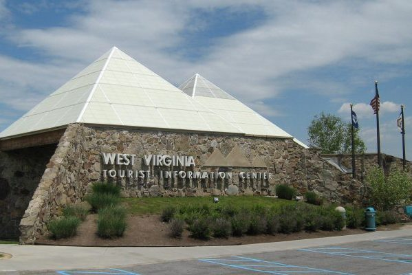West Virginia tourist welcome center, pyramid-shaped brown granite stone walls with aluminum and glass peaks.