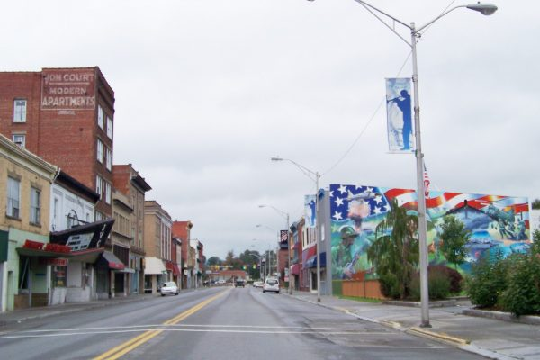 Downtown main street near our Princeton, WV insurance agency office. Old brick mercantile buildings lining street.