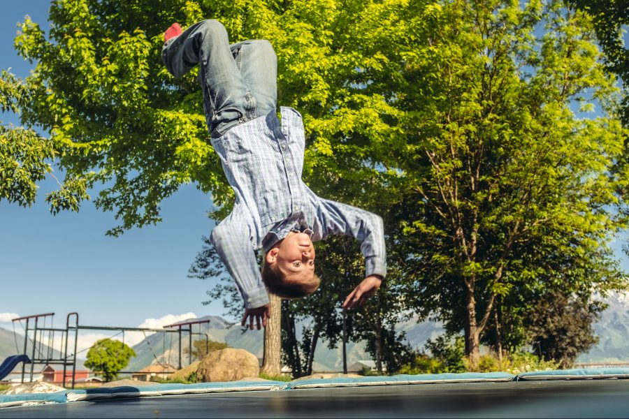 Home insurance red flags, boy jumping on trampoline.
