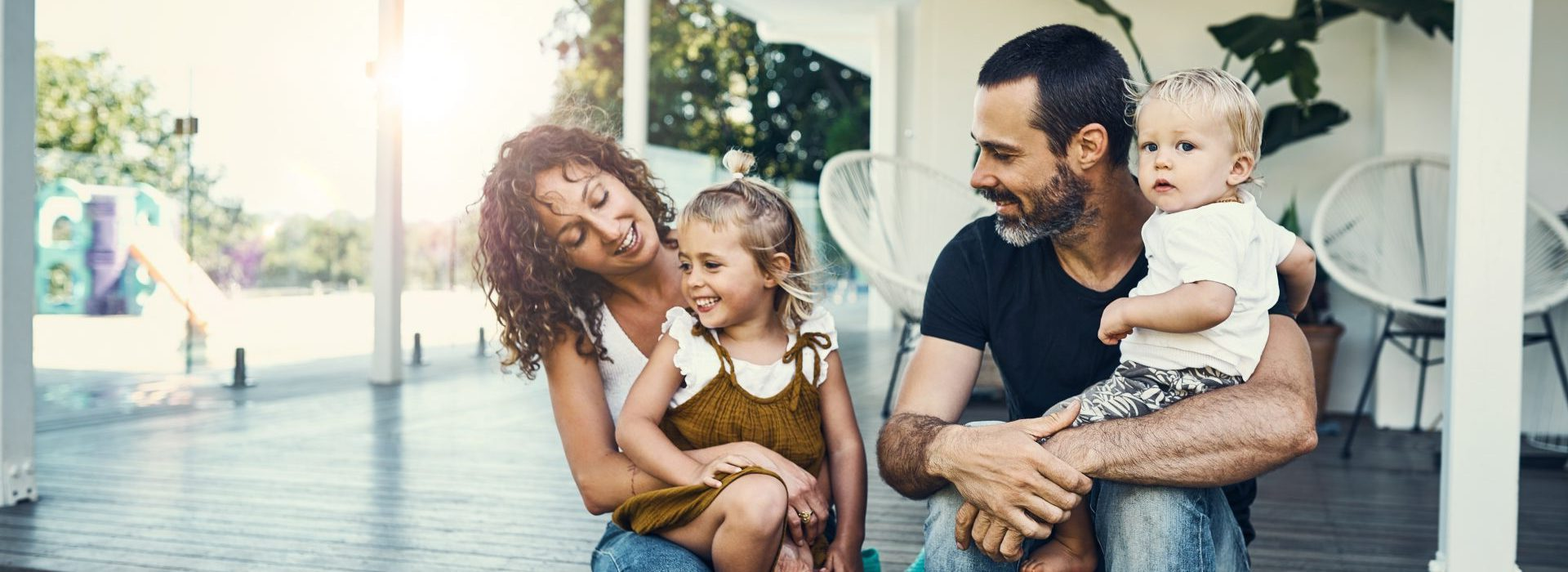 Family sitting on porch of house, symbolizing personal insurance quote from Bankers Insurance.