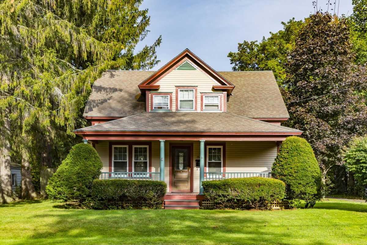 Wooden farm house in craftsman style in need of rental insurance.