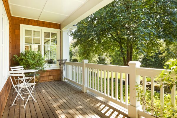 Home insurance represented by an inviting front porch on sunny summer day