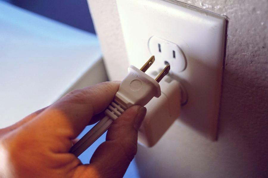Close up of electrical plug indicating a problem wall outlet.