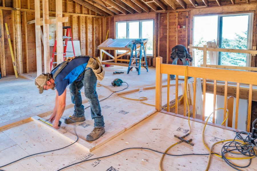 Contractors work on the interior of a home protected by builders risk insurance.