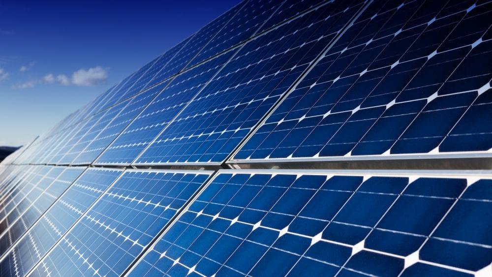 Blue solar panels reflecting sunlight.