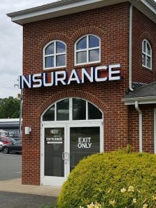 Brick building with INSURANCE sign, our Fredericksburg, VA insurance agency office, formerly Lee-Curtis Insurance
