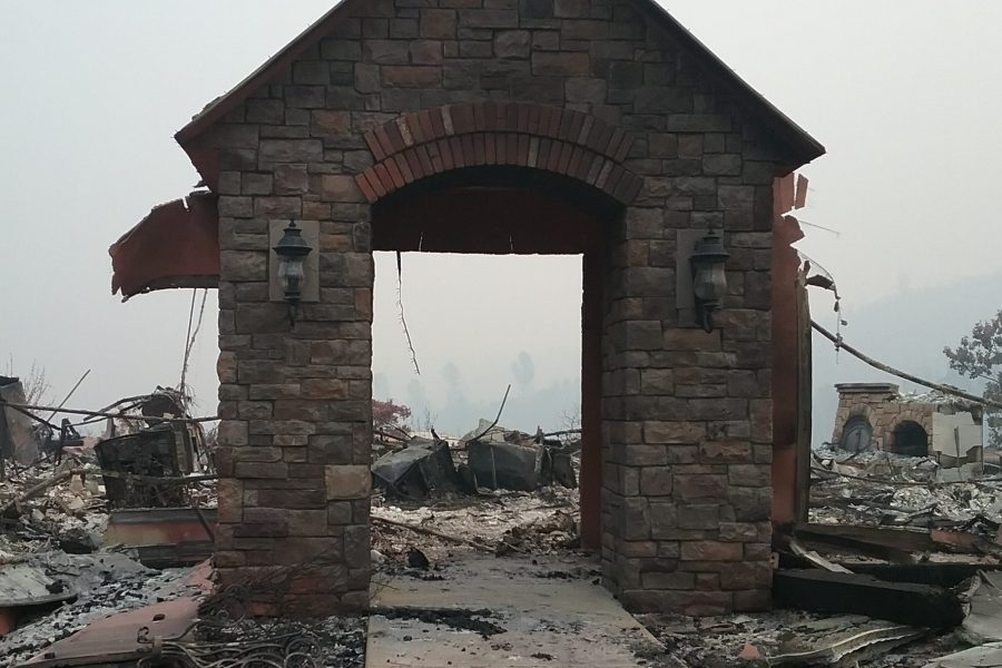 Burned stone entryway without home at Kincade fire location.