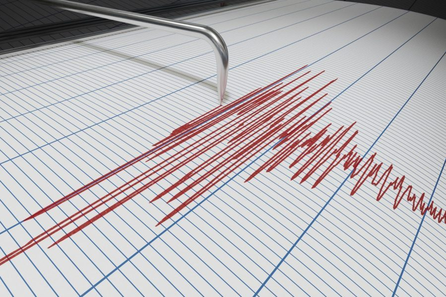Seismograph showing red lines are blue lined paper.