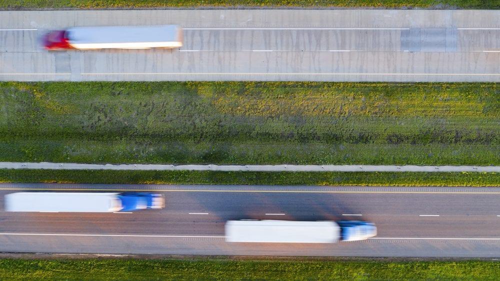 Semi trucks on highway - Uninsured Underinsured Motorist Coverage