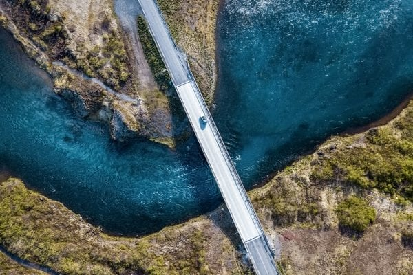 Bridge over blue water representing Guaranteed Asset Protection GAP insurance for vehicles.