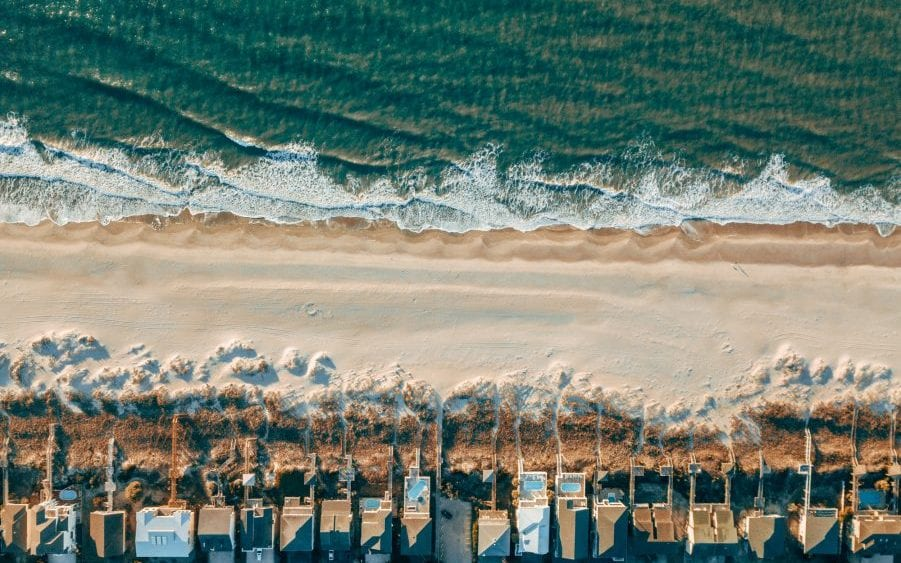 Aerial view of vacation homes on beach.