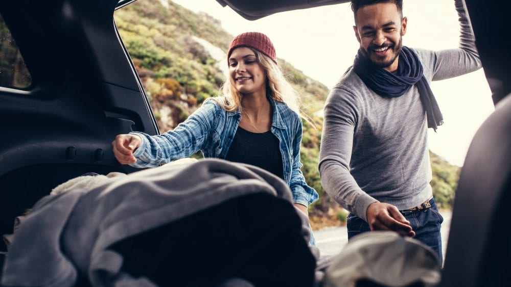 Happy couple covered by rental car insurance