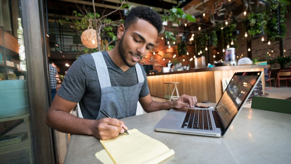 Restaurant owner calculating his medical loss ratio benefit distribution requirement.