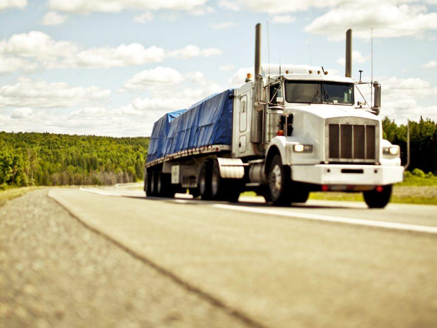Semi tractor trailer on highway.