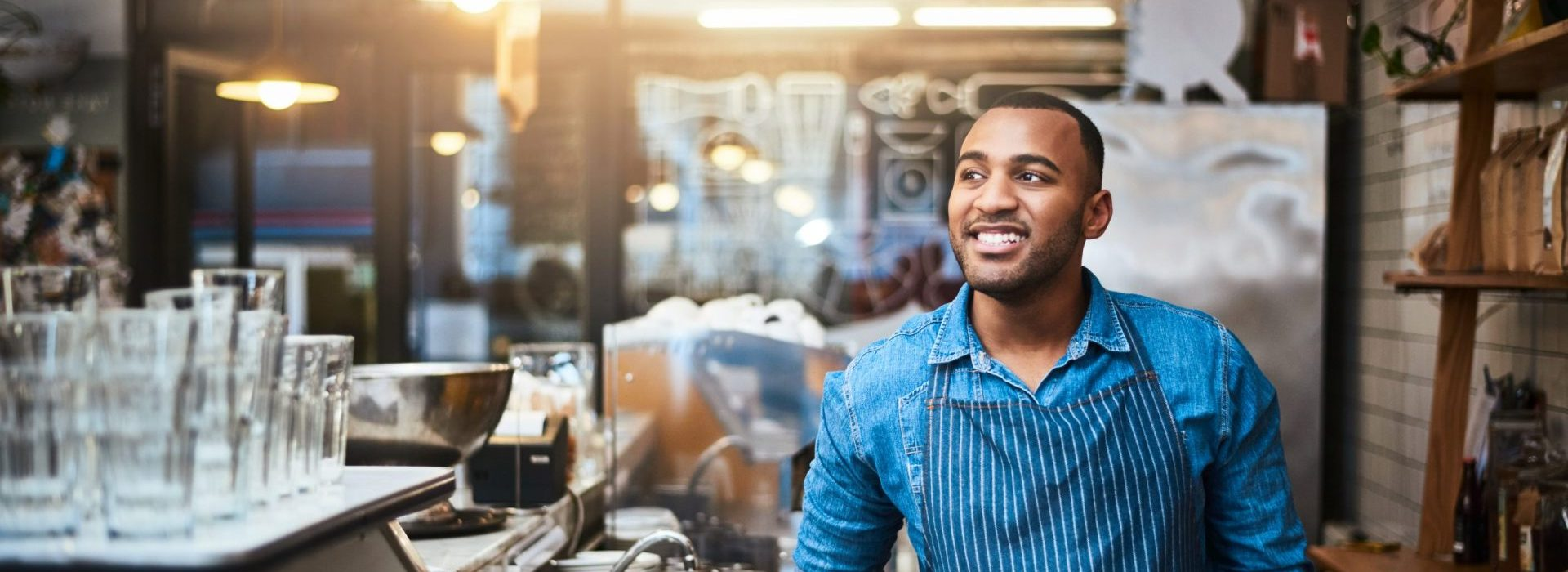 Young man working in kitchen of his restaurant.