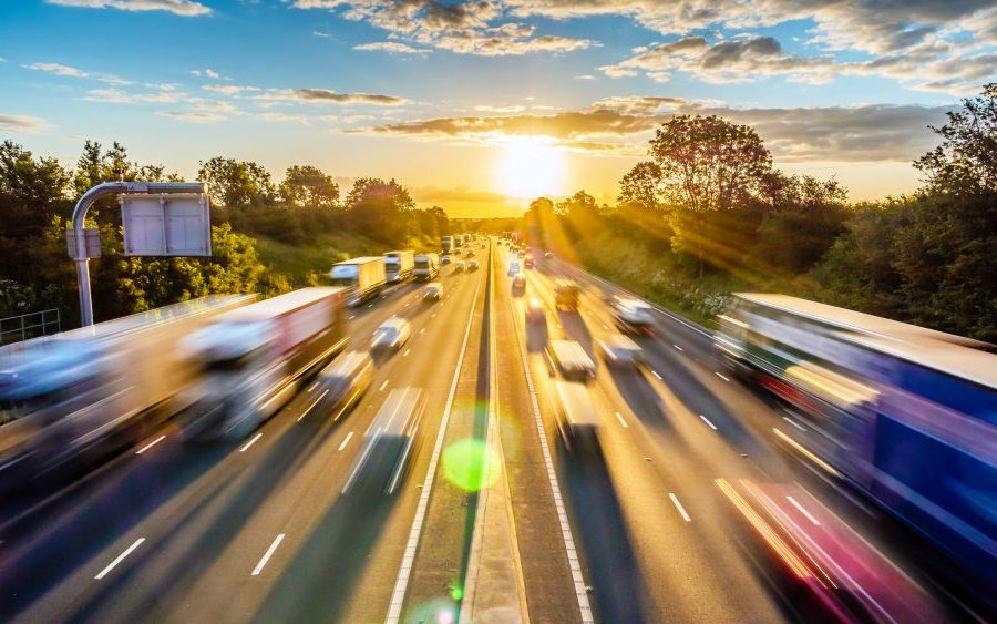 Traffic on highway motion blur with sunrise background.