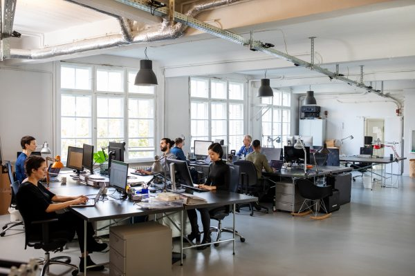 Business people working in a busy open plan office.