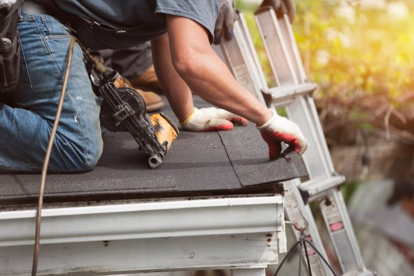 Roofers working on roof insurance claim repair.