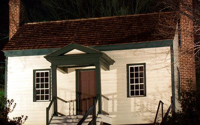 Snuggs House Museum in Albemarle, NC, small old white building.