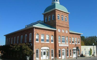 Grand brick building with green copper roof.