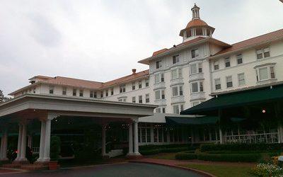 Pinehurst resort, large, white, five story hotel and resort.
