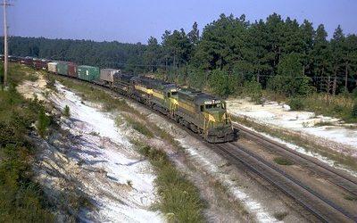 Cargo train on snowy tracks.
