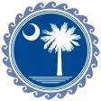 Round blue seal with palmetto tree and moon.
