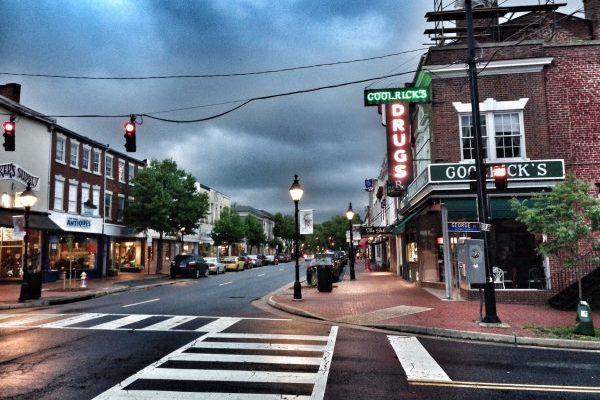 Downtown Fredericksburg, VA shops on street on an overcast day.